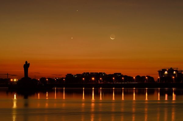 Rare view of Jupiter, Venus and Moon cosmic triangle formation at Hussain Sagar